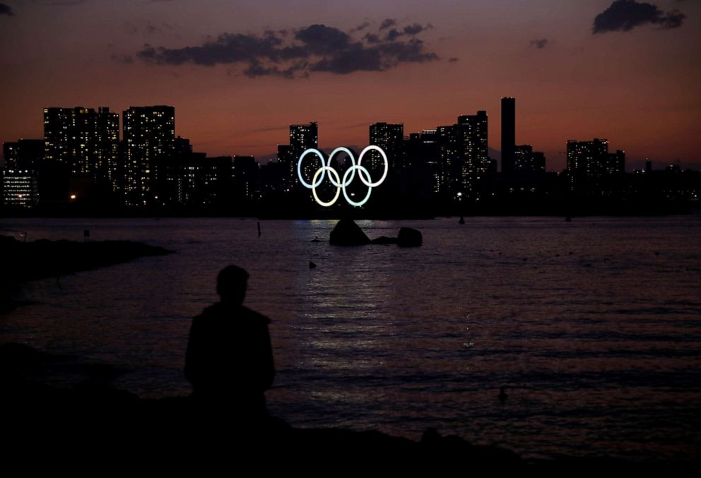 PHOTO: The giant Olympic rings are seen in the dusk at the waterfront area at Odaiba Marine Park in Tokyo, Japan, on March 22, 2020.